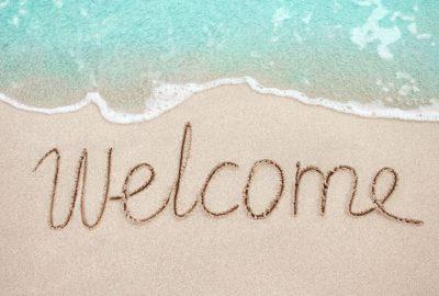 Welcome Gastenontvangst Calpe, Benidorm, La Nucia, Albir, Alfaz, Altea geschreven in het zand